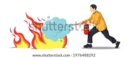 Man using a fire extinguisher to extinguish a fire  Stockfoto ©