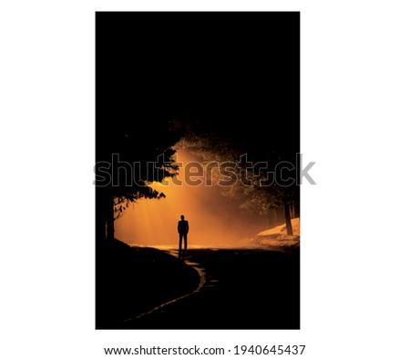 man walking alone on night