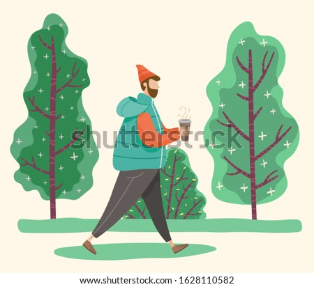 man walking in park or forest