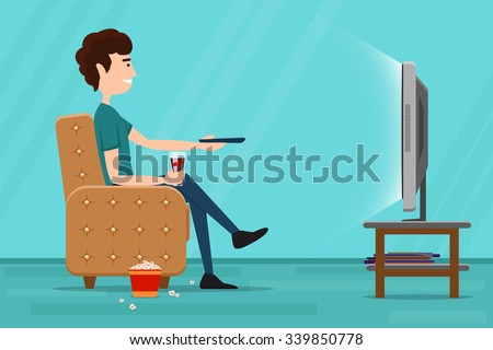man watching television on