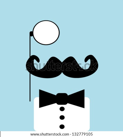 man with monocle and bow tie