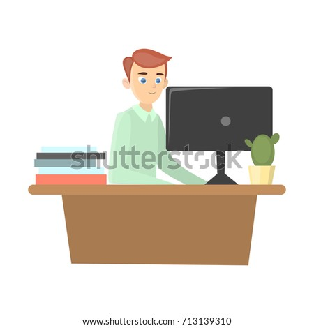 man works in office with desk