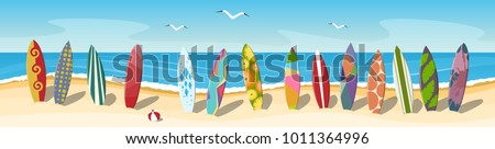 many multi colored surfboards