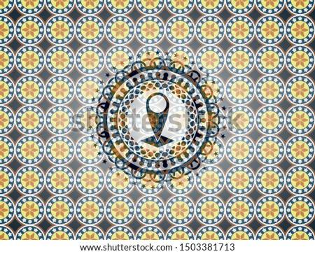 map pointer icon inside arabesque style badge. arabic decoration.