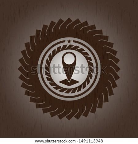 map pointer icon inside wood emblem
