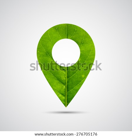 Map pointer icon made of green leaf on gray gradient background.