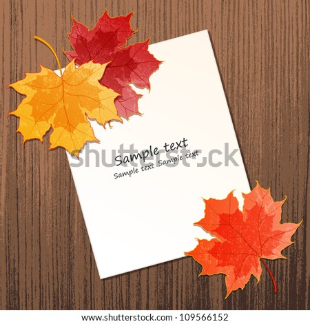 Maple leaves with paper sheet on wooden background texture. EPS 10 vector illustration. Contains transparency effects.