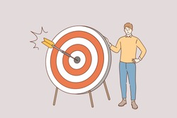 Marketing strategy and purpose concept. Young positive man cartoon character standing holding dart board with direct hit on target meaning goal achievement and success vector illustration