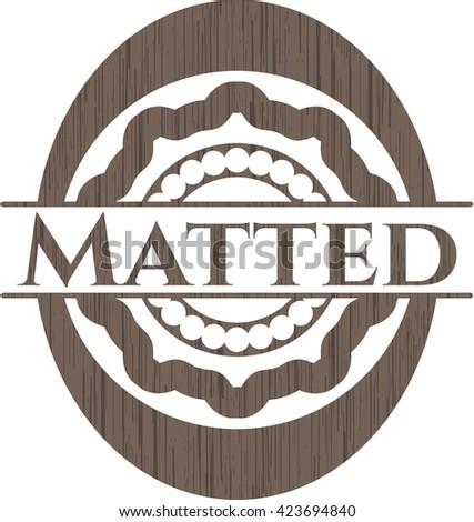 Matted wood emblem