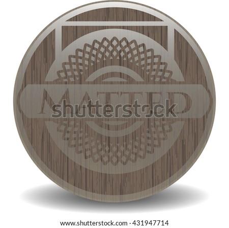 Matted wooden emblem