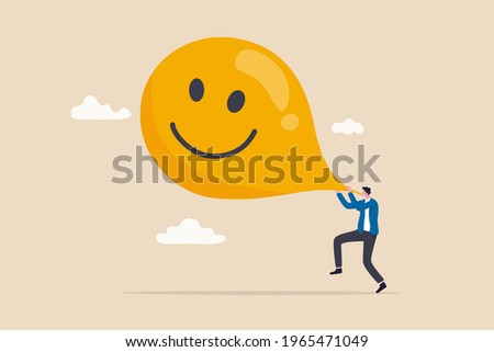 Maximize happiness, let go anxiety and think positive concept, man blow big smile yellow balloon. Сток-фото ©