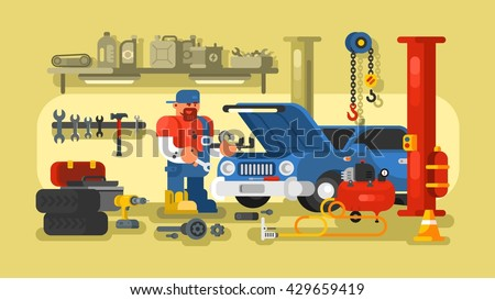 Mechanic Repairs Car in the Garage