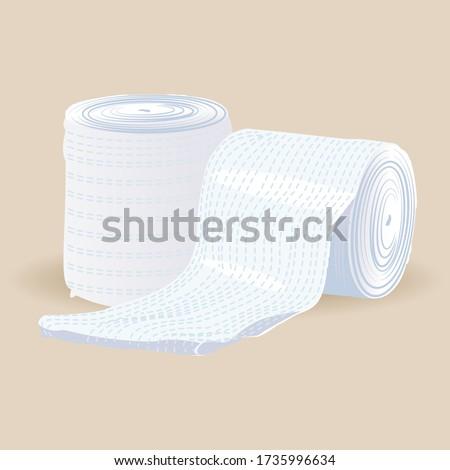 Medical bandage roll on light brown background. Sterile bandage. Stock photo ©