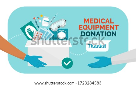 Medical equipment donation during coronavirus covid-19 pandemic, volunteer holding a donation box filled with medicines, surgical gloves and face masks, solidarity concept Foto stock ©
