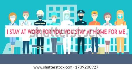 medical staff facing hospital