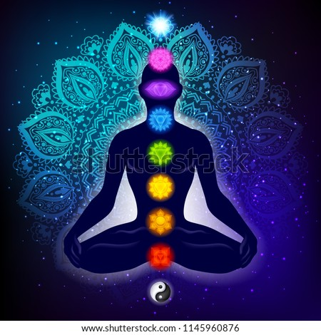 Meditating human in lotus pose. Yoga illustration. Colorful 9 chakras and aura glow. Mandala background.