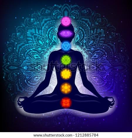 Meditating woman in lotus pose. Yoga illustration. Colorful 7 chakras and aura glow. Mandala background.