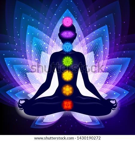Meditating woman in lotus pose. Yoga illustration. Colorful 7 chakras and aura glow. Sacral lotus flower background.
