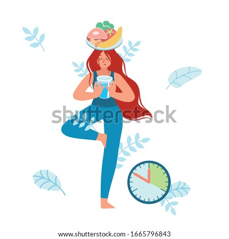 Meditating woman, stand balanced in  tree pose, holding a glass of water in her hands, and a plate with healthy food on her head. Waiting for time to eat. Intermittent fasting. Yoga. Patience.