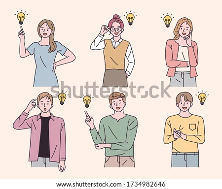 Men and women are thinking of ideas. Bulb decoration. flat design style minimal vector illustration.
