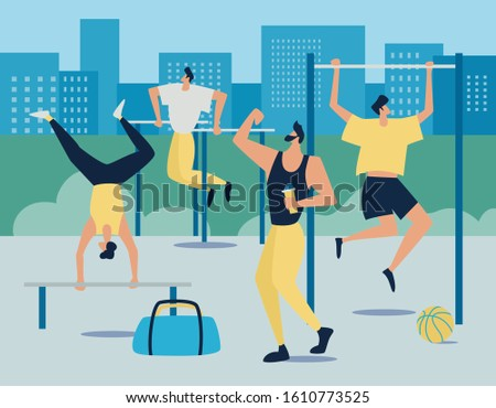 Men outside workouts, physical activity in the sport area, men doing different training. Workout at sports equipment. Street workout exercises.