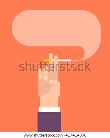 men's hand holds a cigarette