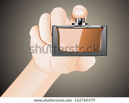 Mens hand with perfume bottle