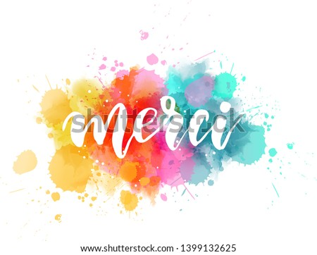 Merci - Thank you in French language. Handwritten modern calligraphy lettering text on multicolored watercolor paint splash background. Foto d'archivio ©