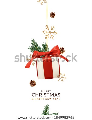 Merry Christmas and Happy New Year. Background with realistic festive gifts box. Xmas present. white boxes with red ribbon gift surprise. Decorative ornament gold snowflake, pine cone, spruce branches Stockfoto ©