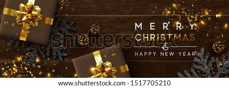 Merry Christmas and Happy New Year. Brown background from wooden boards, snowflakes with glitter sparkle, realistic pine cones, holiday gift boxes. Xmas garlands and gold confetti, presents box