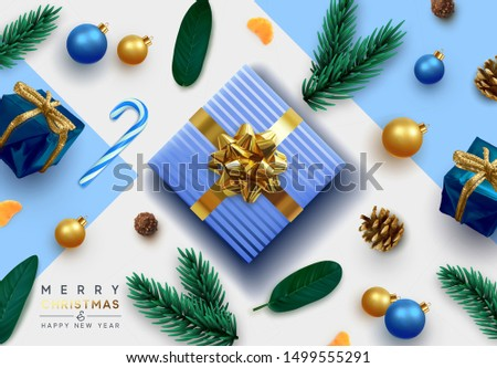 Merry Christmas and Happy New Year. Festive background with realistic design elements. Christmas objects, gift box, decorative pine branches, pine cone, bauble, Xmas ball. flat lay, top view