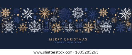 Merry Christmas and Happy New Year festive design with border made of beautiful snoflakes in modern line art style. Winter dark blue background with falling snow. Xmas decoration. Vector illustration.