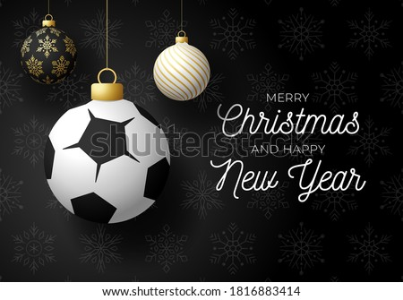 Merry Christmas and Happy New Year luxury Sports greeting card. Soccer Football ball as a Christmas ball on black background. Vector illustration.
