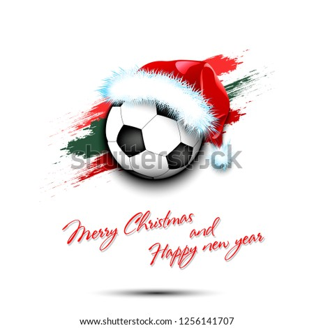203039fd5117d Merry Christmas and Happy new year. New year and soccer ball in santa hat on