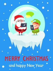 Merry Christmas and Happy New Year poster with Santa and Elf are messaging by their laptops in glass bowl isolated on blue background wit snowfall