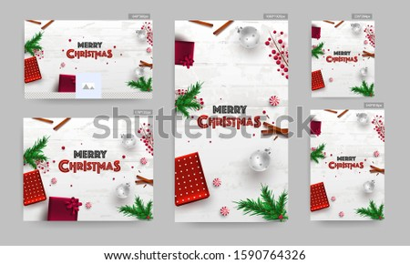 Merry Christmas Banner, Poster and Template Design. Top view of Gift Boxes with Pine Leaves, Baubles, Candy, Cinnamon and Red Berries Decorated on White Wooden Texture Background.