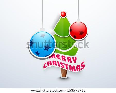 Merry Christmas celebration background with Xmas Tree and hanging decorated Xmas balls on blue background.