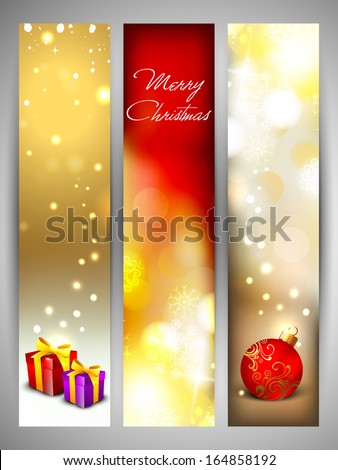 Merry Christmas celebration website banner set decorated with shiny snow flakes, Christmas ball and gift boxes.