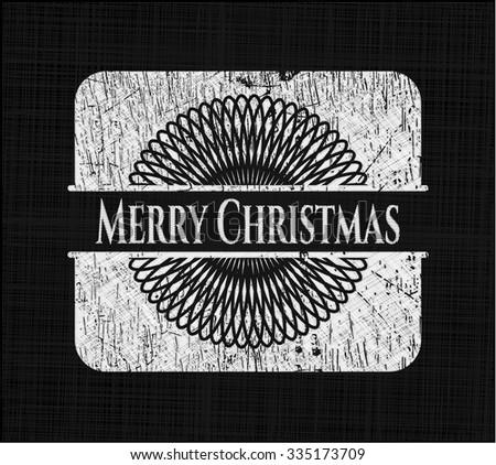 Merry Christmas chalk emblem written on a blackboard
