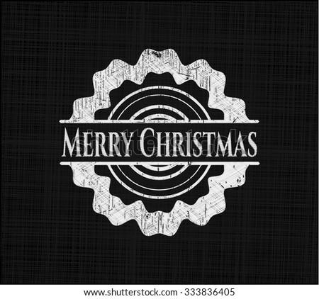 Merry Christmas chalkboard emblem on black board