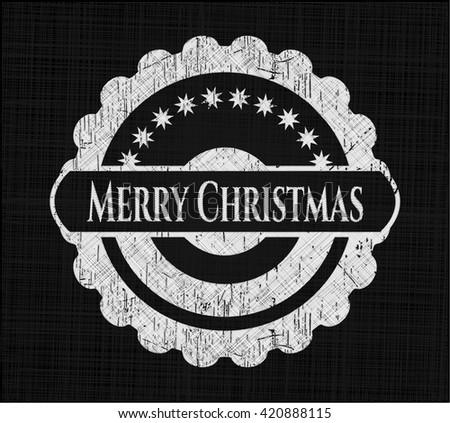 Merry Christmas chalkboard emblem written on a blackboard