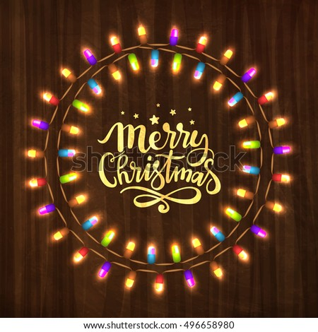 Merry Christmas greeting card design with colorful lights decorated circular frame on wooden background.