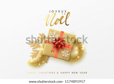 Merry Christmas greeting card. Xmas holiday background, gift box with gold tinsel and bright golden snowflake. French text Joyeux Noel.