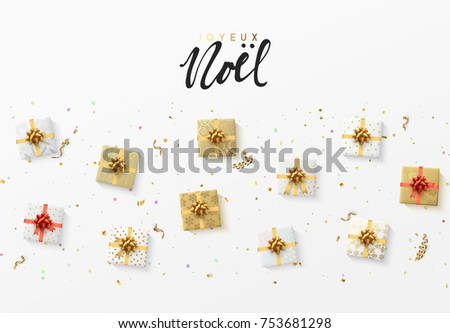 Merry Christmas greeting card. Xmas holiday background, gift box with gold tinsel, bright glitter confetti and golden serpentine. French text Joyeux Noel.