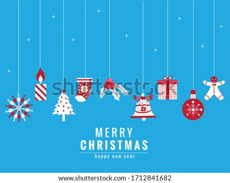 Merry Christmas title with hanging Christmas ornaments and falling snow blue background