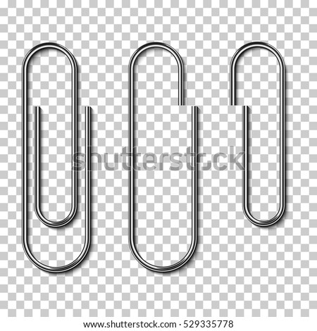 Metal paper clips isolated and attached to paper