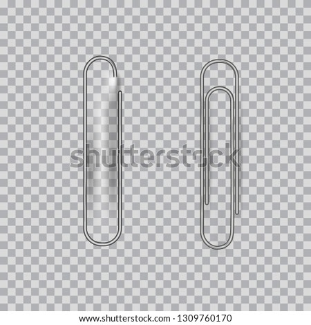 Metal paper clips on transparent background,  one clip attached to paper