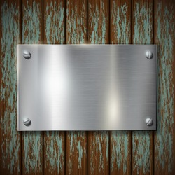 metal plate on a wooden wall