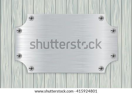 metal plate on light wooden