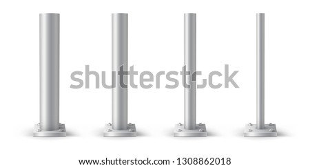 Metal pole bolted on square base. Set of metal poles with different diameters. Steel footings for road sign, banner or billboard.